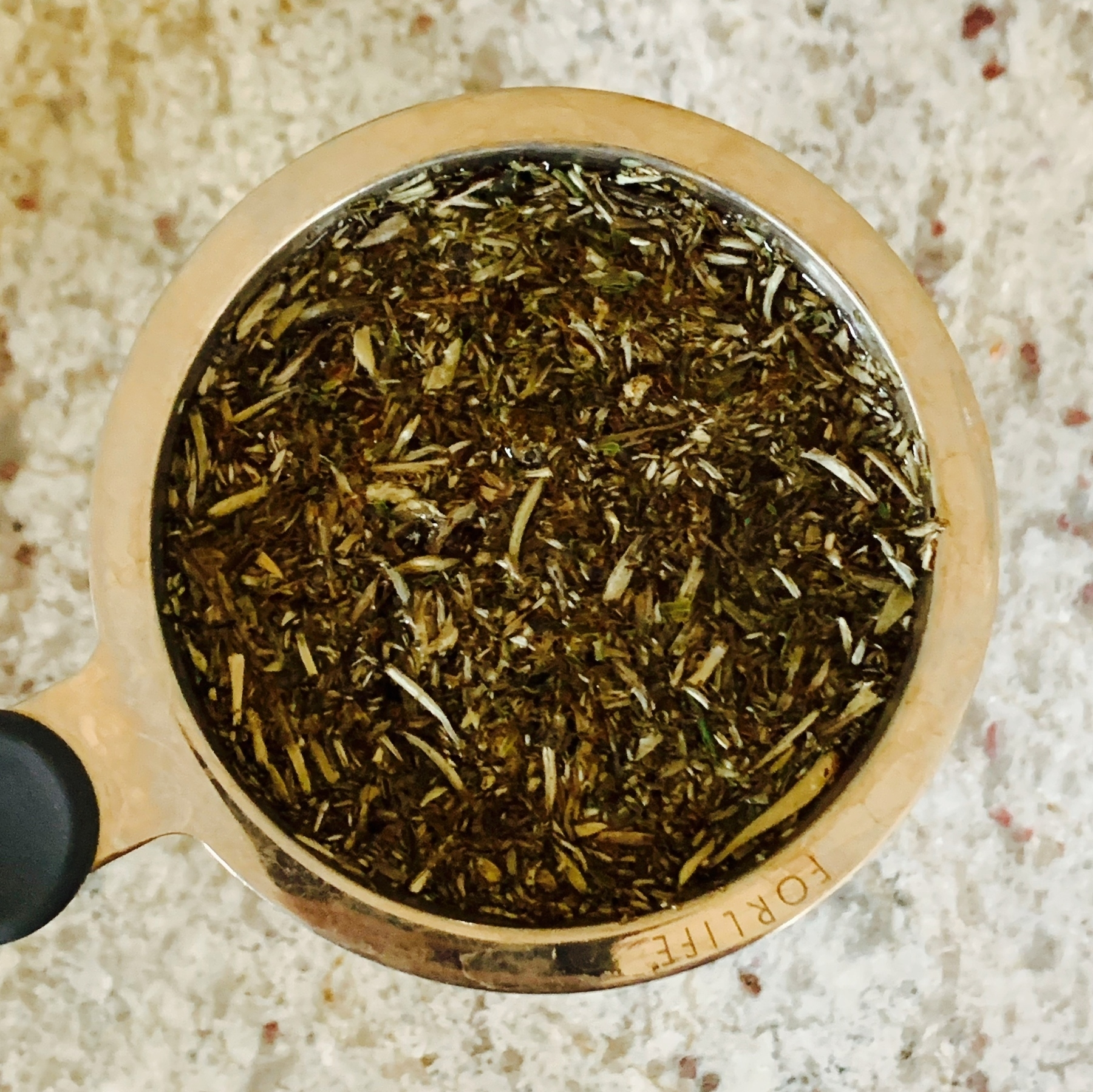 top down view of steeping tea leaves