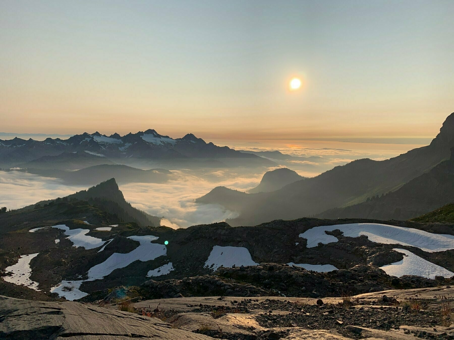 sunset view of mountains and mist at sunset from ½ way up Mt Baker in Washington, US