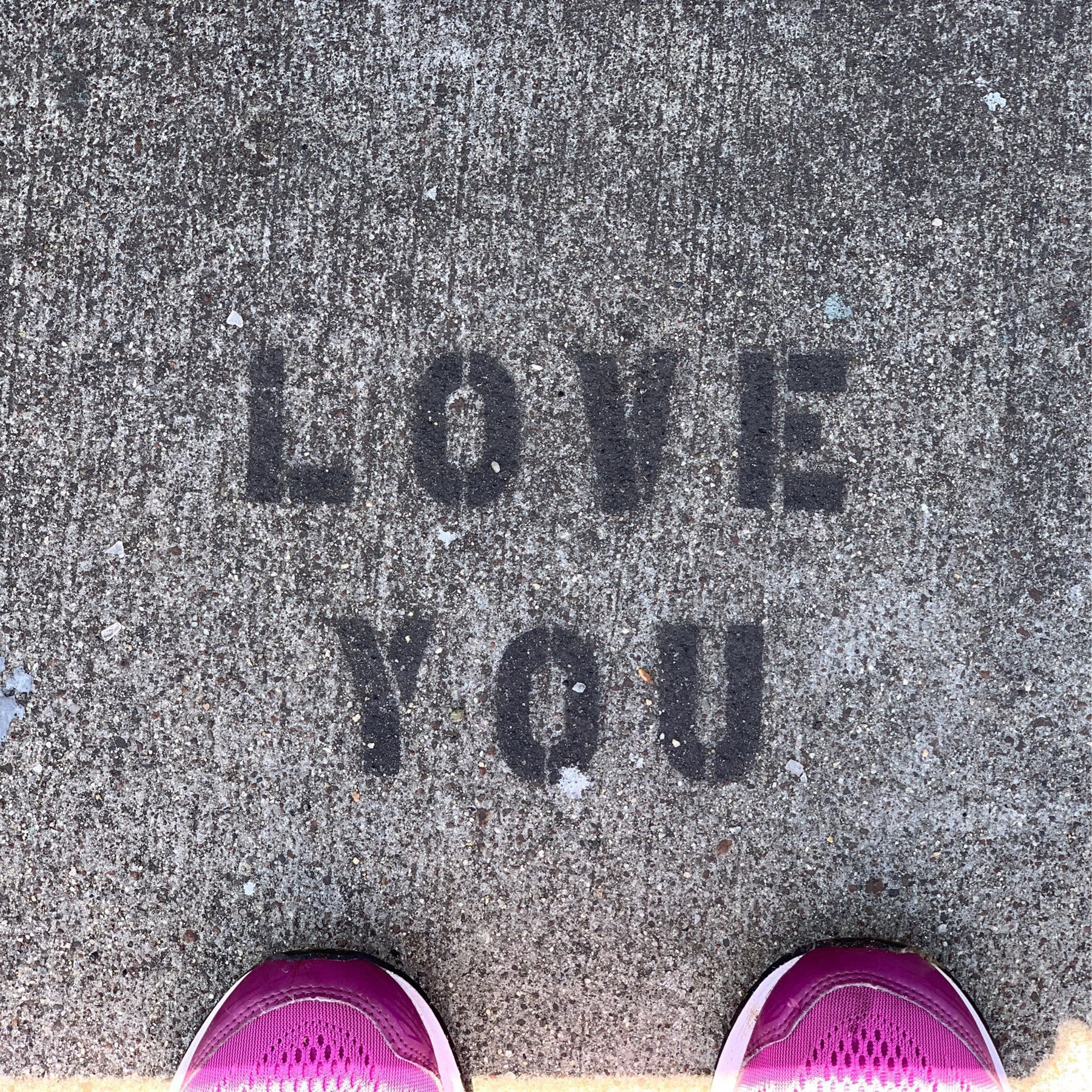 stenciled LOVE YOU on the sidewalk