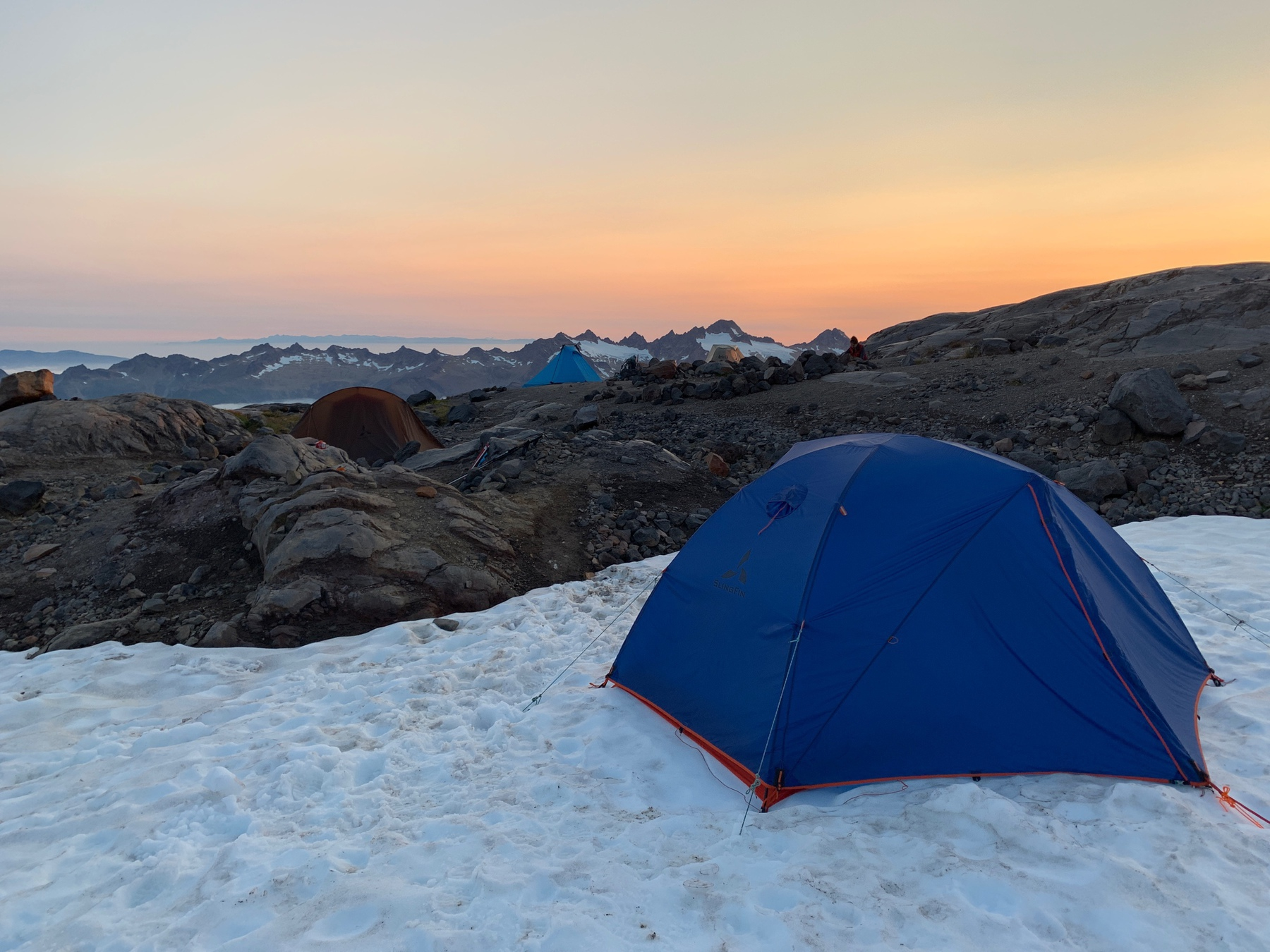 blue tent at sunset on top of Mt Baker, WA, US